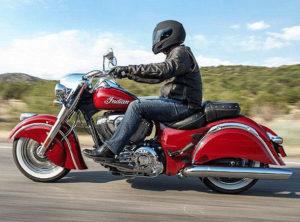 man on motorcycle wearing a helmet