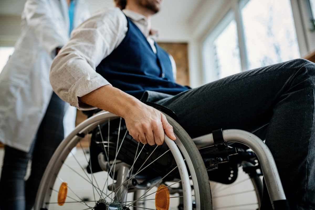 Man in wheelchair with physical disability post accident